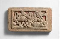 Stylized depiction of a camel inside a rectangular border.