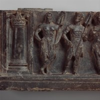 Rectangular piece of carved stone with raised relief images of a column, two men holding shades, and a third man gesturing with his hand