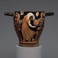red figure ceramic vessel depicting a dancing womam wearing a long dress