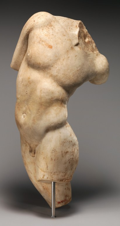 Statue of a headless male figure turning his torso. Arms and legs are missing too, but the dynamic pose shows the figure looking at his tail (also missing).