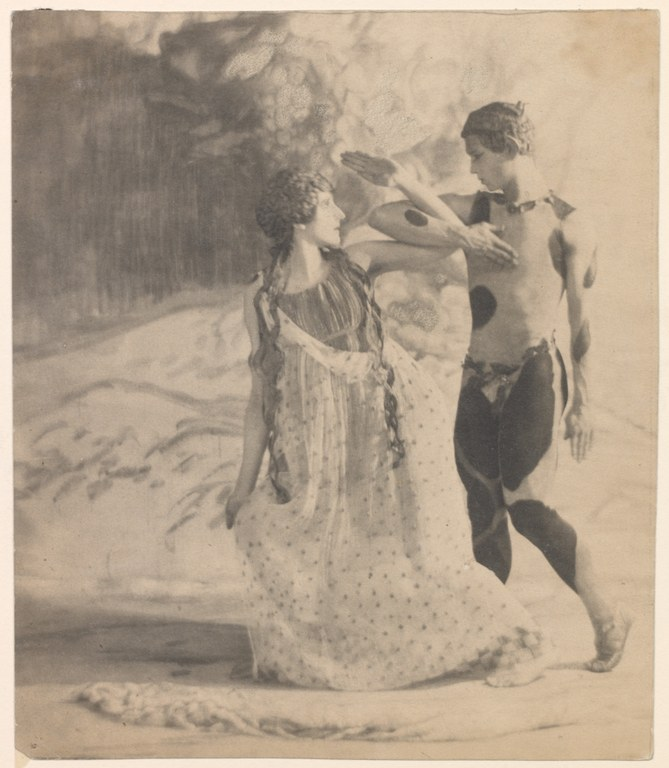 Photograph in a painterly style of a woman in a long sleeveless dress and a man in an animal print leotard, interlocking elbows while staring into each others eyes.