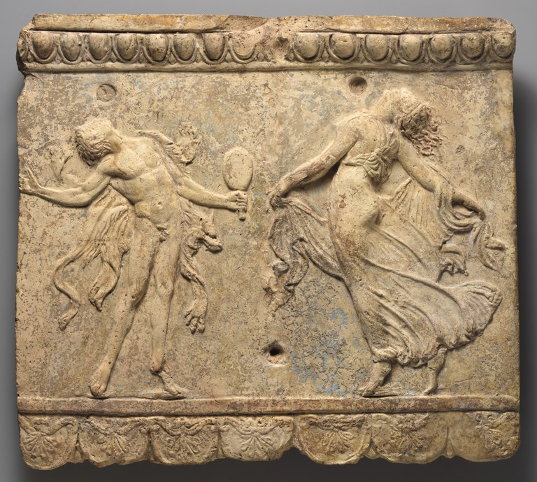 Relief of a man and a woman dancing, facing each other while arching backwards, with small trees in the background. The man is nude, but for a lion skin. The woman wears a long, sleeveless dress.