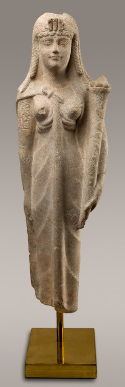 Statue of a standing woman wearing a headdress and a gown, holding a staff in her hand.