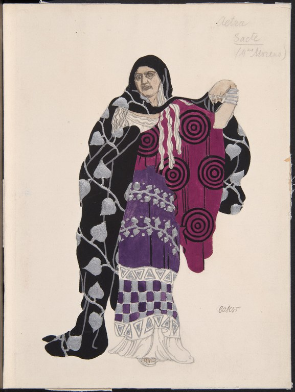 Painting of an old woman dressed in a purple and and pink gown, wrapping herself in a black and grey scarf with an ivy pattern. Annotations in pencil read: Aetra. Bacte. (Mdme. Moreno). BAKST.