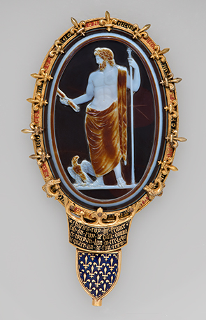 Oval-shaped sardonyx cameo of Jupiter with eagle, staff, and lightning bolt. Set in an elaborate gold and enamel mount.