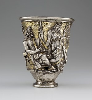 Silver and gold beaker with seated and standing male and female figures in repoussé.