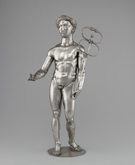 A silver statuette of Mercury, holding caduceus.