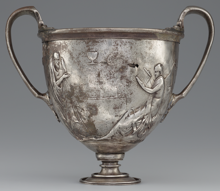 Photograph of a silver, two-handled cup decorated with male figures