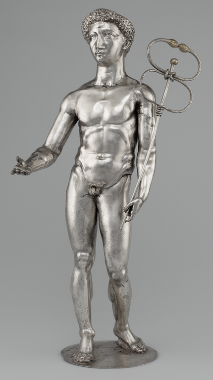 Photograph of silver statuette depicting Mercury nude, holding the caduceus