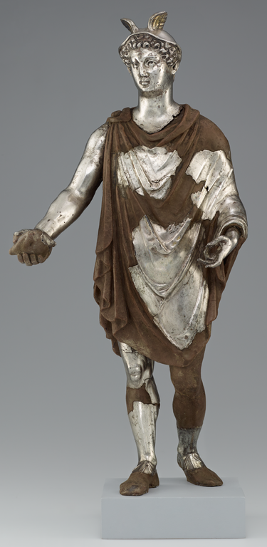 Photograph of fragmentary silver statue of Mercury with winged cap