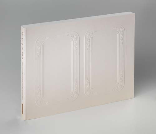 A photograph of the hard-bound volume, which features an off-white cover with two embossed rectangular patterns on the front and the title and editor's names in gold script on the spine.