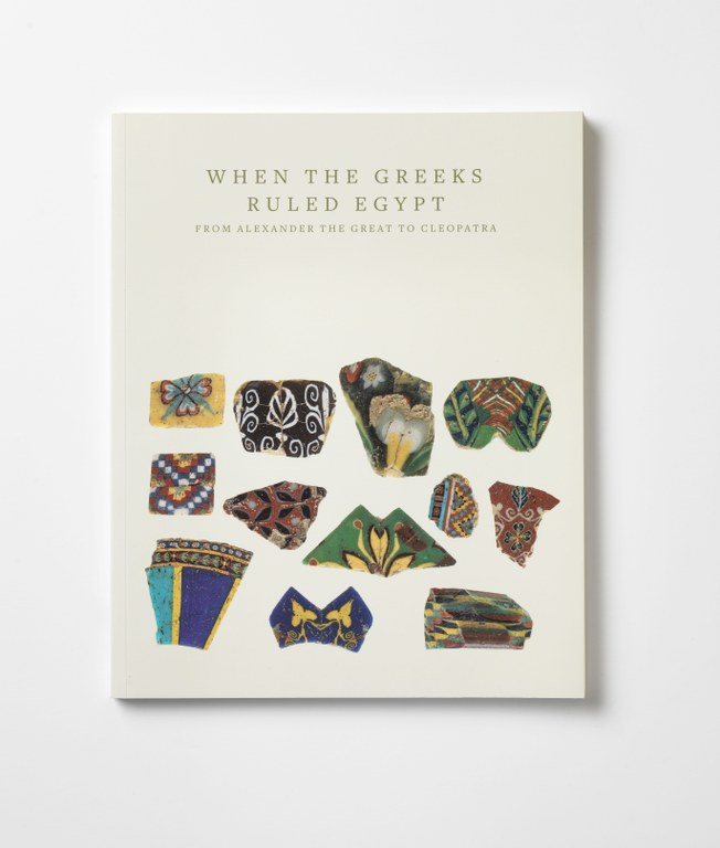 Photograph of cover of the volume. It is an off-white color with the title and editors' names centered at top. Pictures of several colorful, fragmentary ceramic pieces fill the the bottom two-thirds of the cover.