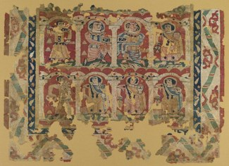 Tapestry weave of dyed wools and undyed linen, a: H. 103 cm; W. 148.2 cm. b: H. 5.5 cm; W. 15.5 cm. Egypt, ca. 6th–8th century CE. Brooklyn Museum, Charles Edwin Wilbour Fund, 46.128a–b. This wall hanging depicts an arcade of three stories or more of servants at work on behalf of the household. They carry flowers, baskets, and chalices piled high with fruit. In the fuller, original composition, these figures may have represented a calendar with personifications of the months, bearing the earth's bounty for each month, thereby ensuring prosperity for the household.