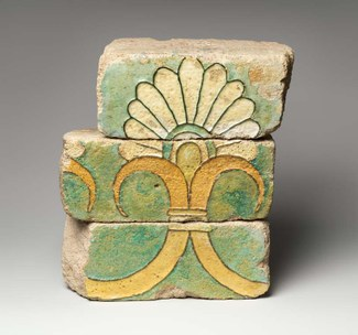 Three fragmentary bricks with palmette motif