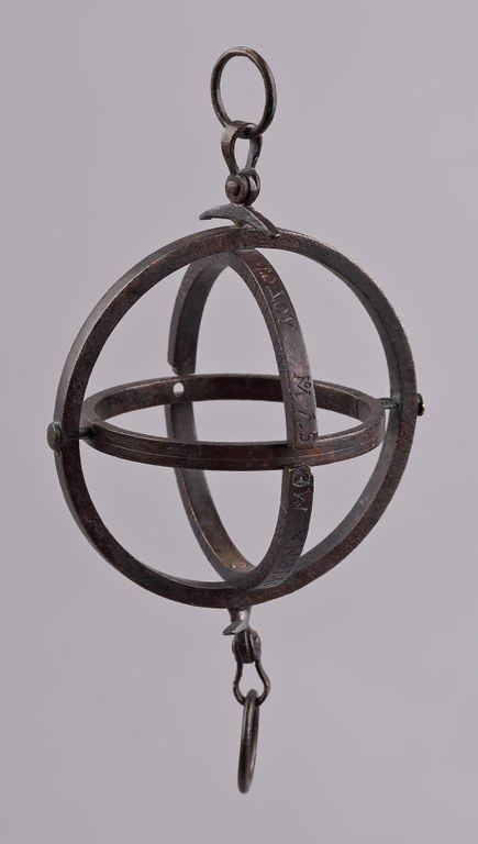 Image of a portable three-ringed armillary sundial made of copper alloy.