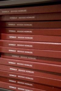 Stack of books with red binding