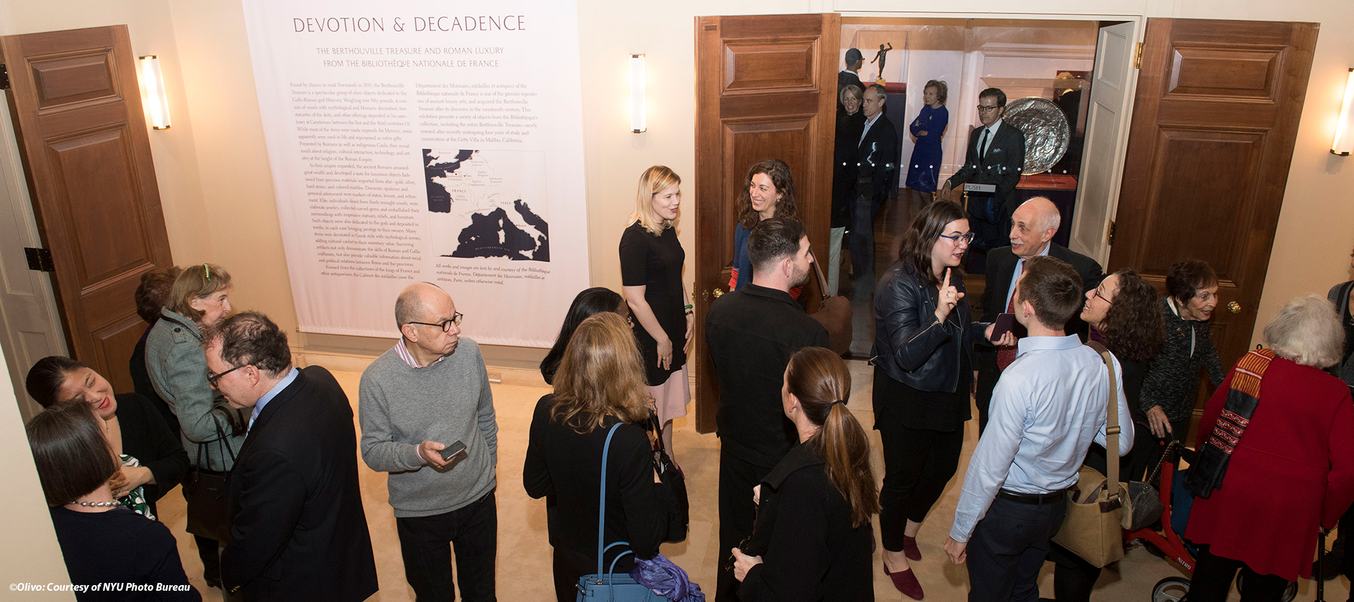 Image of a crowd mingling at the reception for the opening of the Devotion and Decadence show