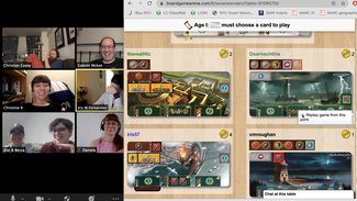 """A screenshot of a split screen, with a Zoom Meeting of members of the ISAW Community on the left side and cards and boards from the virtual board game """"7 Wonders"""" on the right."""