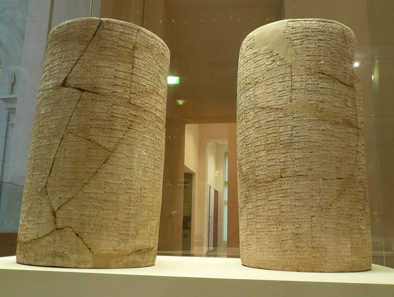The Cylinders of Gudea, the longest continuous Sumerian text, at the Louvre Museum (photo by Ramessos via wikimedia)