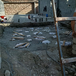 Construction site showing the tips of several wine vessels buried underground