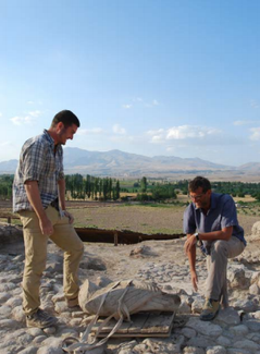 A student and professor secure the eagle statue to a palate