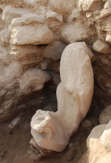 The large eagle statue in situ at the excavation site