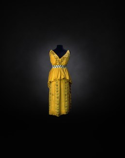 A yellow silk dress costume with painted black leaf motifs
