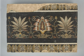 Small roman mosaic depicting lotus flowers and palmettes in stone and glass decorations