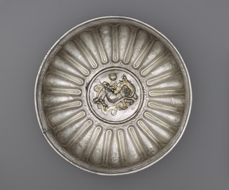Silver bowl depicting a sleeping Omphale in silver and gold relief