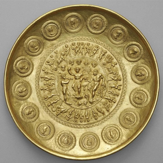 A gold bowl depicting Bacchus and Hercules surrounded by mounted coins