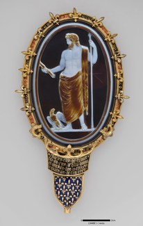 A small gem set in a gold mount depicting Jupiter with a scepter and eagle