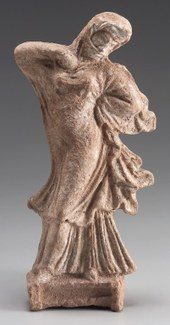 Statuette of a veiled woman, wearing a long dress, dancing