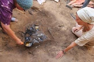 Restorers consolidating a wooden plaque, Hissorak 2013. Photograph courtesy of Judith A. Lerner