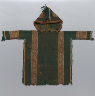A green hooded tunic with golden edging, two vertical bands in red and gold, red and gold bands circling both sleeves, and patterns in red and gold on the hood is photographed lying flat.