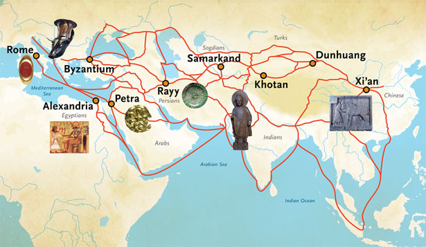 On a map extending from the central Mediterranean east to China across southern Asia, a series of red lines indicate trade routes. Superimposed on them are key cities (like Rome, Alexandria, Petra, Samarkand, Khotan, Dunhuang, and Xi'an) as well as icons representing physical objects from various cultures.