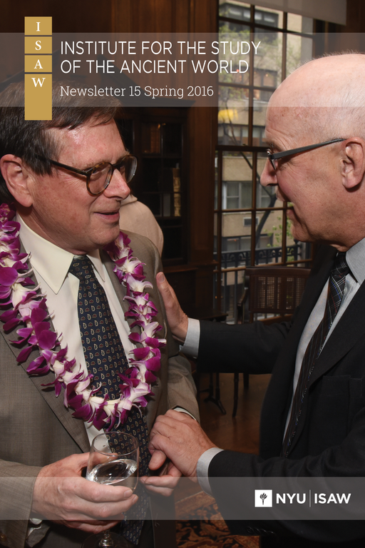 Newsletter Cover: The title and logo are overlaid on a photograph in which two men smile and converse. They are in a wood-panelled room with a window behind them. Both are wearing semi-formal clothes. The man on the left has a necklace of white and purple flowers.