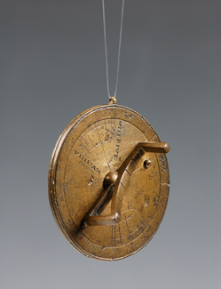 Image of a portable universal bronze circular sundial with roman numerals on it. The circular sundial resembles a pocket watch
