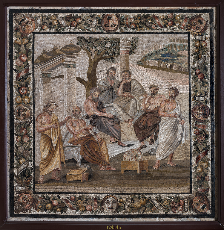 An intricate mosaic depicting severazl men in robes sitting and standing under a tree with a landscape in the background. See text of article for further description.