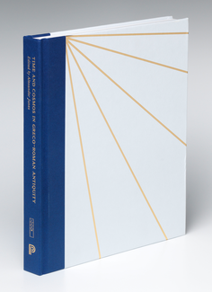 A hard-bound book stands on its edge. The front cover is white with a series of radiating cold lines. The spine is blue, and on it appears indistinct text written in gold type.