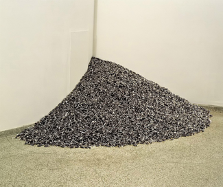 Photograph of a pile of blue-gray pieces of candy in a corner.