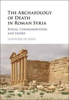 In a white area in the top half of the cover, the title and autthor's name appears. The bottom half of the cover contains a photograph of a partially ruined structure made of stone blocks and fronted by a colonade and the remains of the triangular pediment above.