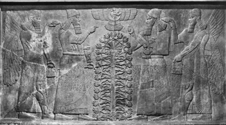 A black and white photo depicts a stone engraving showing two bearded individuals on each side of a stylized plant or tree atop which a winged and tailed symbol is carved. Each of the outer figures also has wings. Indistinct text covers the area from the figures' waists to their knees.