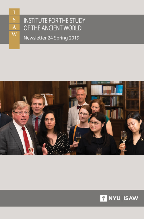 Cover of the newsletter features the ISAW logo and title of the newsletter. Centered is a picture of several people holding wineglasses in a room with bookshelves.