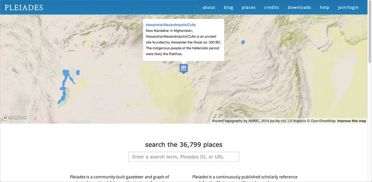"""A computer screen capture shows a blue menu bar, a large map with a single blue symbol and a pop-up menu. Below these the text """"search the 36,799 places"""" and a search bar appear."""