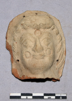 nicely executed head fragment of a specimen of a terracotta figurine together with later deposits in yet another trench