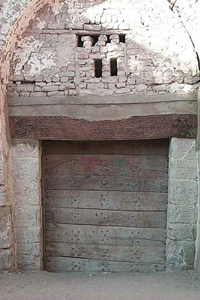 Fig.2 The house of Abu Nafir in al-Qasr. Note the reuse of stone and the carved lintel.